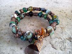 Bracelet, handmade, memory wire bracelet, with green nature glass beads and bronze metal tibetan beads (231).