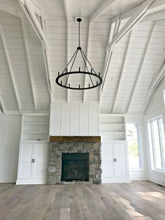 Black iron chandelier planked ceiling