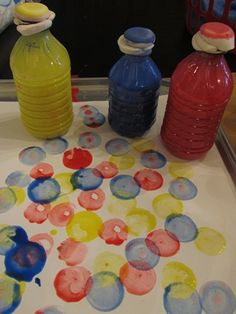 DIY dot dabbers: water bottle; 1/3 full of paint; fill the rest with water; rubber band make up sponges to the top; squeeze gently