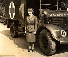 Standing to attention: Princess Elizabeth in full uniform poses next to an Austin K2 Ambulance.    Queen Elizabeth II; World War II