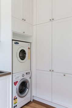 Storage galore in this hampton style laundry designed by Zesta Kitchens