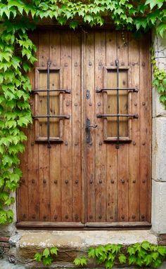 One of our properties in Tossa de Mar, Girona, Spain Vintage Doors, Antique Doors, Portal, Girona Spain, Gate Way, Clothes Racks, Mexico House, Fairy Doors, Entry Ways