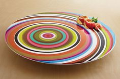 Just an idea for decorating the Lazy Susan. I like the way the off centered circles would get dizzying as it spins.