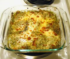 Pesto Chicken baked with pesto and topped with mozzarella cheese.  Simple, delicious.