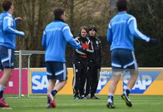 Head coach Joachim Loew and assistant coach Thomas Schneider look on during a Germany training...