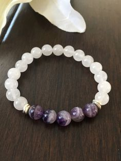 A personal favorite from my Etsy shop https://www.etsy.com/listing/479754086/amethyst-snow-quartz-and-silver-beaded