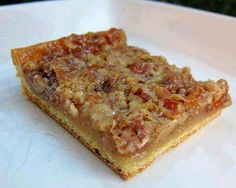 ~ pecan pie bars ~1 can (8 oz) crescent rolls ~3/4 cup chopped pecans ~ 1/2 cup sugar ~ 1/2 cup corn syrup ~2 Tbsp butter or margarine, melted ~ 1 tsp vanilla ~ 1 egg, beaten ~ heat oven to 350°F ~  unroll dough and press in bottom and 1/2 inch up sides of a 9x13-inch pan ~ firmly press perforations to seal ~ bake 8 mins ~ ~ meanwhile, in medium bowl, mix remaining ingredients ~ pour filling over partially baked crust ~ bake 18 to 22 minutes longer or until golden brown ~ cool 1 hour ~