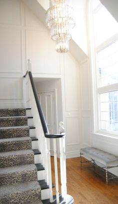 Christine-Dovey-Barringham-foyer-3-leopard-stair-runner-painted-railing-wall-moulding-chandelier stairs