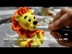 This is part two of a two part series showing you how to make a lion topper out of fondant.  For more detailed information and other great cupcake and cake decorating ideas please visit http://www.cutecupcakeideas.net or follow me on facebook at http://www.facebook.com/pages/Cute-Cupcake-Ideas/232520133474429