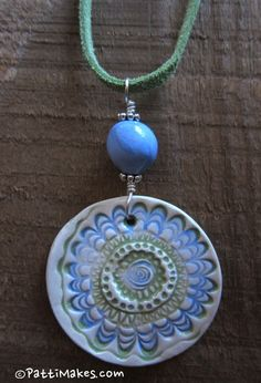 "Blue and Green Fun Floral Ceramic Pendant and Bead - Handmade by Patti @ <a href=""http://PattiMakes.com"" rel=""nofollow"" target=""_blank"">PattiMakes.com</a>"