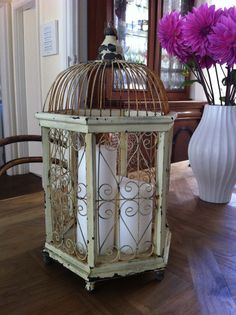 SOLD!!! Bird cage decoration - This is a vintage birdcage made out of wood and wire. It is the perfect prop to sit on any table and can be filled with anything: Candles; flowers; wedding wishes etc. I purchased it from Bowral vintage fair originally and it absolutely stunning.