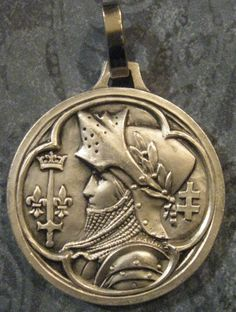 This is a lovely French vintage religious medal.    The front depicts Joan of Arc in armor with her coat of arms and the Cross of Lorraine.  The