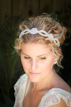 This is a gorgeous bridal headband is adorned with silver inlay glass beads and very sparkly rhinestones. This beautiful headband is attached to