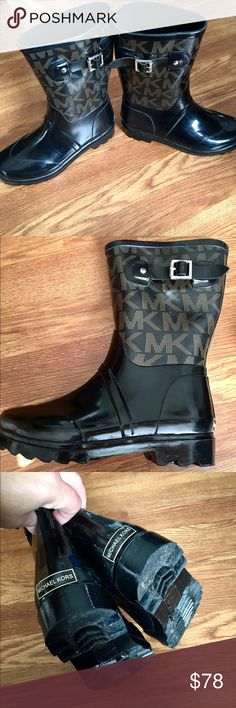 Michael Korea mid calf Rain Boots Like New!! Worn maybe twice! Like new! Authentic 100%! I unfortunately threw away the box!  Product Details: The Michael Kors rain boot marries fashion and function for even the gloomiest weather conditions. Logo and side buckle detail. Rubber Canvas, lightly padded insole . Rubber outsole. Flat heel. Style: 40H0MKFB7Z MK.  Specifications: 7M MaterialCanvas/ Rubber #rainboots #MK #michaelkors #boots #shoes #black #logo Michael Kors Shoes Winter & Rain Boots