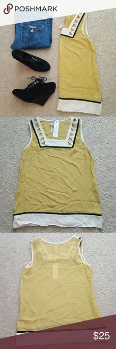 """Mystree mustard blouse New with tags! Mystree (Boutique) sheer chiffon blouse. Mustard, black and cream. Adorable cut out triangle design at neck and thin black lattice detail at neck and bottom.   100% acrylic   Gorgeous by itself or layered under a cardigan or blazer.   Size small. Underarm to underarm 18"""" length 26.5"""" Mystree Tops"""