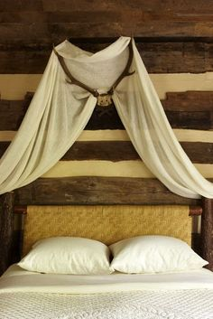 Love this bedroom idea from Kathleen Rivers' Cashier, North Carolina mountain home. Very creative idea to mount antlers and then drape fabric over it for a canopy feel.