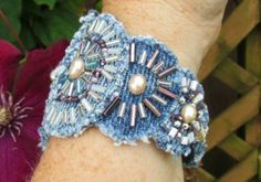 Cut and distressed blue jean round pendant cuff bracelet