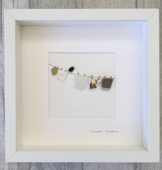 Sea glass and pebble art by CoastalCreationsSG on Etsy https://www.etsy.com/listing/530677037/sea-glass-and-pebble-art