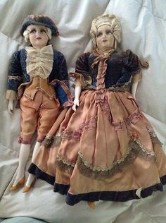 Very Old French Dolls Male and Female Pair Royal Pair | eBay....I won this darling pair of dolls. They are a little smaller than the typical Boudoirs. The male is in great condition but the female is dirty and has some worn spots on her face.  Her Hairstyle is AWESOME
