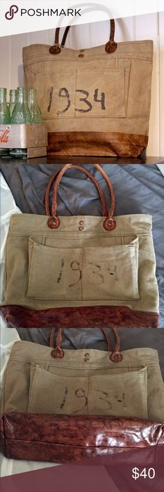 Vintage canvas tote bag Mona B vintage canvas tote bag. It is perfect for everyday with twisted brown leather handles and brass accents. Faded natural green canvas color with two deep outside and inside pockets. It has faded 1934 on front. Mona B Bags Totes