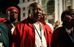 February 12, 2015 - EFF leader, Julius Malema, sporting a torn shirt shortly after being removed fro... - eNCA / Dianne Hawker