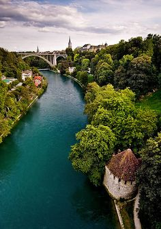 A river seperates Bern Old Town from the remainder of the City in Switzerland.