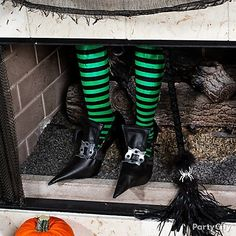Looks like this wayward witch had to make a crash landing! Click for how-to tips and more Halloween Crafts & DIY Decorating Ideas.