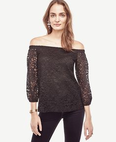 "Styled in corded lace, our off-the-shoulder blouse is ready for wherever the day (or night) takes you. Encased elastic shoulders. 3/4 raglan sleeves with encased elastic cuffs. Side slits. Lined body. 21 1/4"" long."