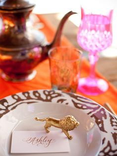 For a bit of whimsy, spray-paint small animal figurines metallic gold, then place in the center of each plate