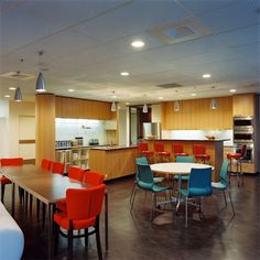 A Simple Breakroom Setup With Colorful Chairs. Medical Office Design, Office  Space Design,