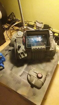 This is a finished pip boy for cosplay purposes. It does not include glove or phone. The phone case dimensions measure 137 x 71 x 20 mm. The front