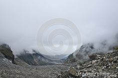 Glacier on mist background in hailuogou china ,cloudy day. cable car moving