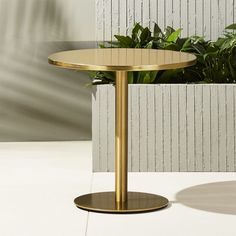 Shop watermark brass bistro table.   Warm brass slicks up the classic bistro table in this modern interpretation by Mark Daniel of Slate Design.  Elevated on a sleek pedestal frame, finely textured top echoes the round shape of the smooth base.
