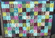 Teal, green, and purple quilt; double diagonal quilting.