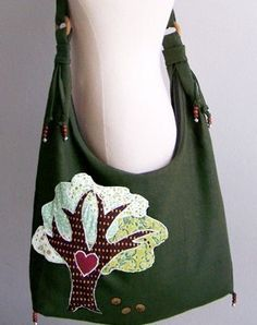 sling bag with tree applique