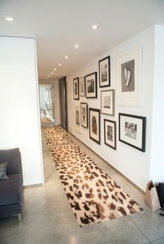 leopard rug, concrete floor and b&w; gallery wall