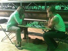 Josh and Woody Harrelson playing chess on the set of The Hunger Games - josh-hutcherson Photo