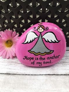 Hope is the anchor of my soul. This hand-painted rock features my Alleluia Rocks angel and shares the gift of HOPE! A great gift for someone in need of inspiring words. Rock Painting Patterns, Rock Painting Ideas Easy, Rock Painting Designs, Hope Painting, Pebble Painting, Pebble Art, Painted Rocks Craft, Hand Painted Rocks, Painted Stones