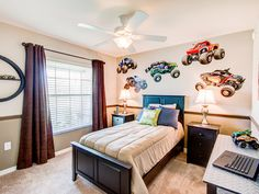Know someone in love with motorsports? This bedroom uses wall decals and plays with rich colors to add personality and flair. Highland Homes' Parker model home in Lake Alfred, Florida Creative Kids Rooms, Highland Homes, Bedroom Pictures, New House Plans, Florida Home, Rich Colors, Model Homes, Home Builders, Kids Bedroom