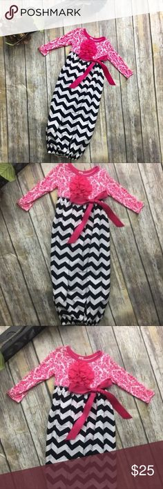 Boutique Chevron Print Pink Design Gown This little beauty is a long sleeve onesie with chevron print attached skirt. This gown is made with 100% cotton. Beautiful pink and white onesie design and white and black chevron print skirt with elastic around bottom. Size xs comparable to 0 to 3 months. Only 1 available! Perfect baby shower gift/ coming home from the hospital Gown etc DekoPosh Dresses