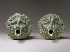 The Roman Empire (27 B.C.–393 A.D.)   Bronze waterspout in the form of a lion mask, ca. 100 B.C.–100 A.D.; late Hellenistic or early Roman; Greco-Roman style, Greco-Roman; From Cyprus, Bronze (74.51.5677)