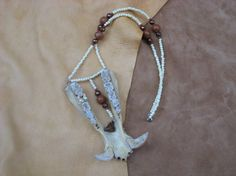 Javelina wild boar jawbone necklace with bone, wood and copper beads