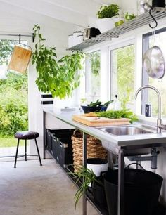 coud hang these ikea type shelves at the top of the kitchen to create hanging space.