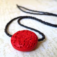 Long necklace red carved cinnabar with black by planettreasures, $25.00