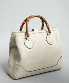 This white leather Gucci tote with bamboo handles..