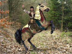 This fantasy scene features a gallant rider on his noble war horse, clad in ceremonial medieval barding. 3D digital render by Jayne Wilson