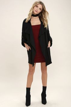 They say luck be a lady, and she must be a fashionable one with numbers like the Lucky Break Black Oversized Jacket! Medium-weight woven fabric in, versatile black, shapes a collared, draping front with vertical welted pockets. Oversized bodice tapers slightly into short dolman sleeves that can be rolled up and kept in place with a handy button tab.