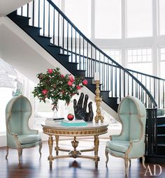 Robins egg blue custom-made porter chairs enliven this foyer | archdigest.com