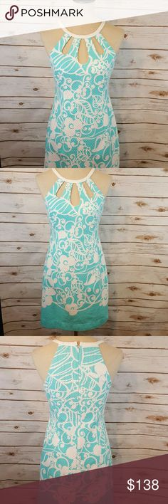 """Lilly Pulitzer  floral swirl dress Lilly Pulitzer dress with triple key holes at chest. Hidden zip on back. Form fitting. Wavy ribbed material is slightly faded purposely, for a textured look. Fully lined. 100% cotton. No stretch.  Bust 32"""" Waist 28"""" Hips 36"""" Length 33"""" Lilly Pulitzer Dresses Mini"""