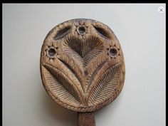 """Rare 19th Century hand carved side handle Butter Print. Carved HEART motif with Leaves and 3 Starbursts. Best original scrubbed surface. This Baby was really used ! But the Heart and other decoration was carved very deep and still retains a great presence. No damage or repairs and measures 6 1/2"""" long and about 3"""" to 3 1/2"""" in diameter. Sold for $1715 on ebay by mtdrum13. 2/8/14."""